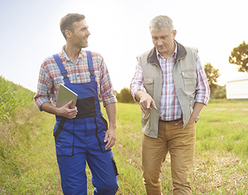 Photo of two farmers in conversation