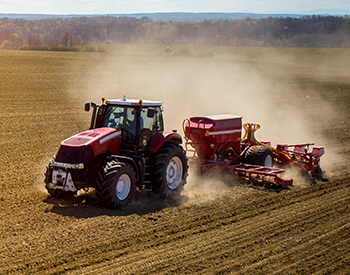 Photo of a tractor plowing a field