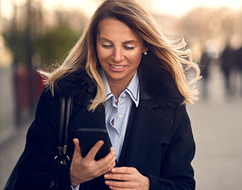 Photo of a woman looking at her cell phone