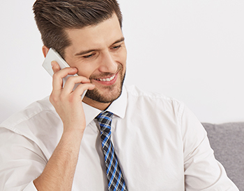 Photo of a man talking on a cell phone